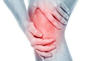 Причины болей в коленных суставах